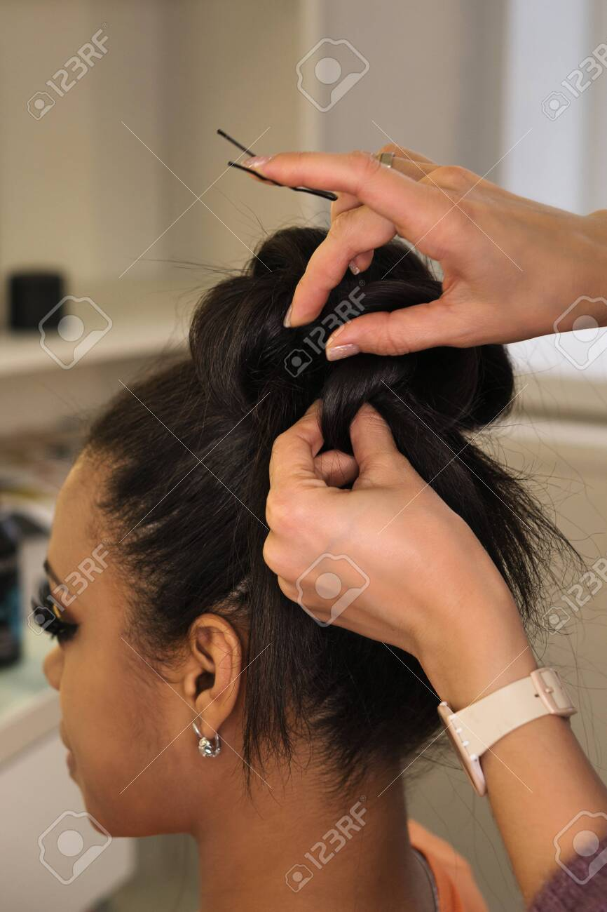 Hands Of Professional Female Hairstylist Make An Evening Hairstyle Stock Photo Picture And Royalty Free Image Image 125951213