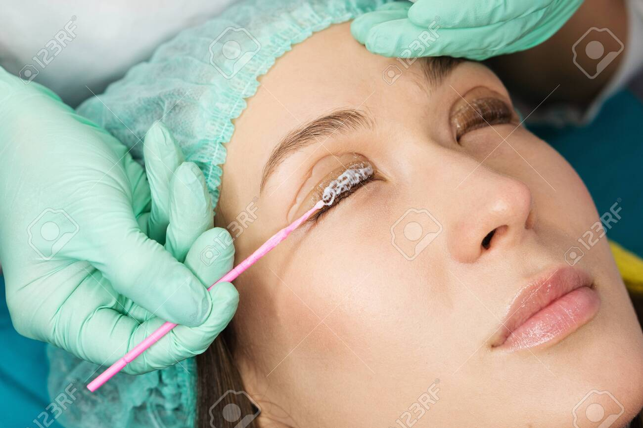 Eyelash care treatment procedures. Staining, curling, laminating for lashes. Beauty model with perfect fresh skin and long eyelashes. Skincare, Spa and Wellness. Close up. Perfect layout - 145226811