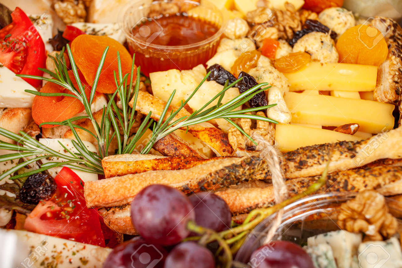 A box of food, cheese, breads, fish, shrimp. Food delivery for the company, romantic, office dinner at home. Beautiful composition of food in a box, convenient carrying, fresh products. - 158116252