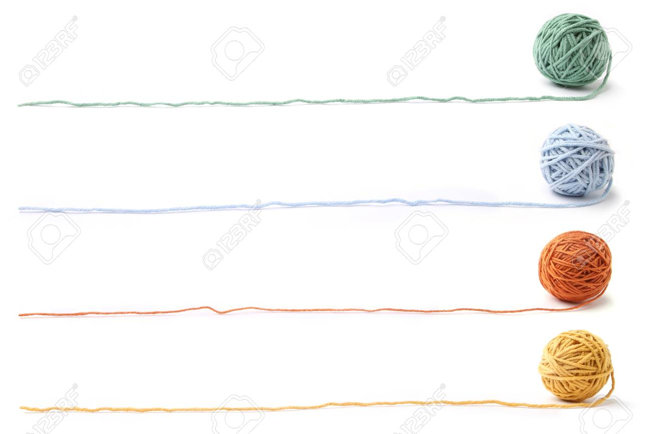 Colorful cotton thread balls isolated on white background. Set of four color (orange, yellow, green, blue) thread balls. - 94319863
