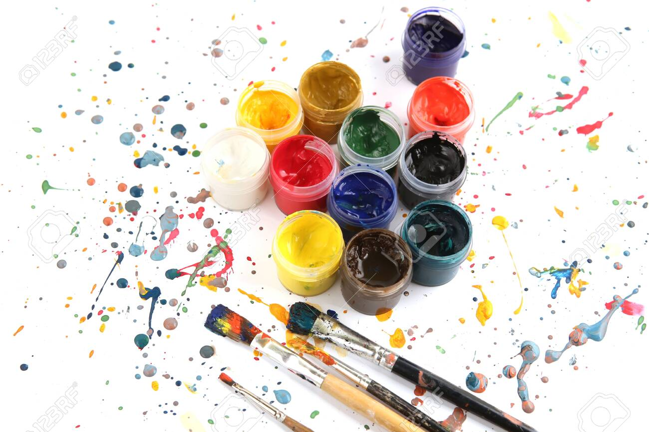 Jars with gouache paints and brushes on colorful paint splashes background. Plastic cans with multi-colored dye for drawing. - 139002191