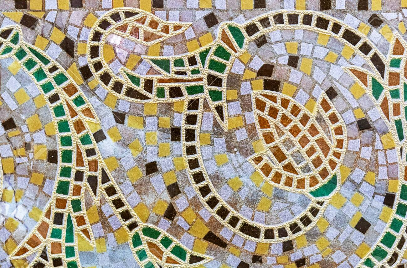Ceramic tile mosaic with floral ornament. Background and texture of ceramic tiles mosaic. - 128862024