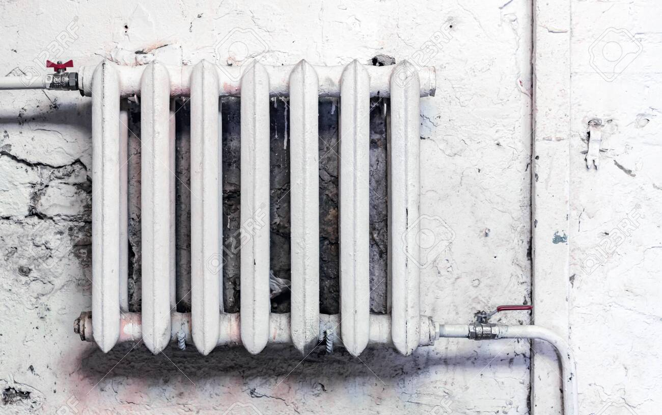 Old Cast Iron Heating Radiator In Grunge Style Stock Photo Picture And Royalty Free Image Image 140246748