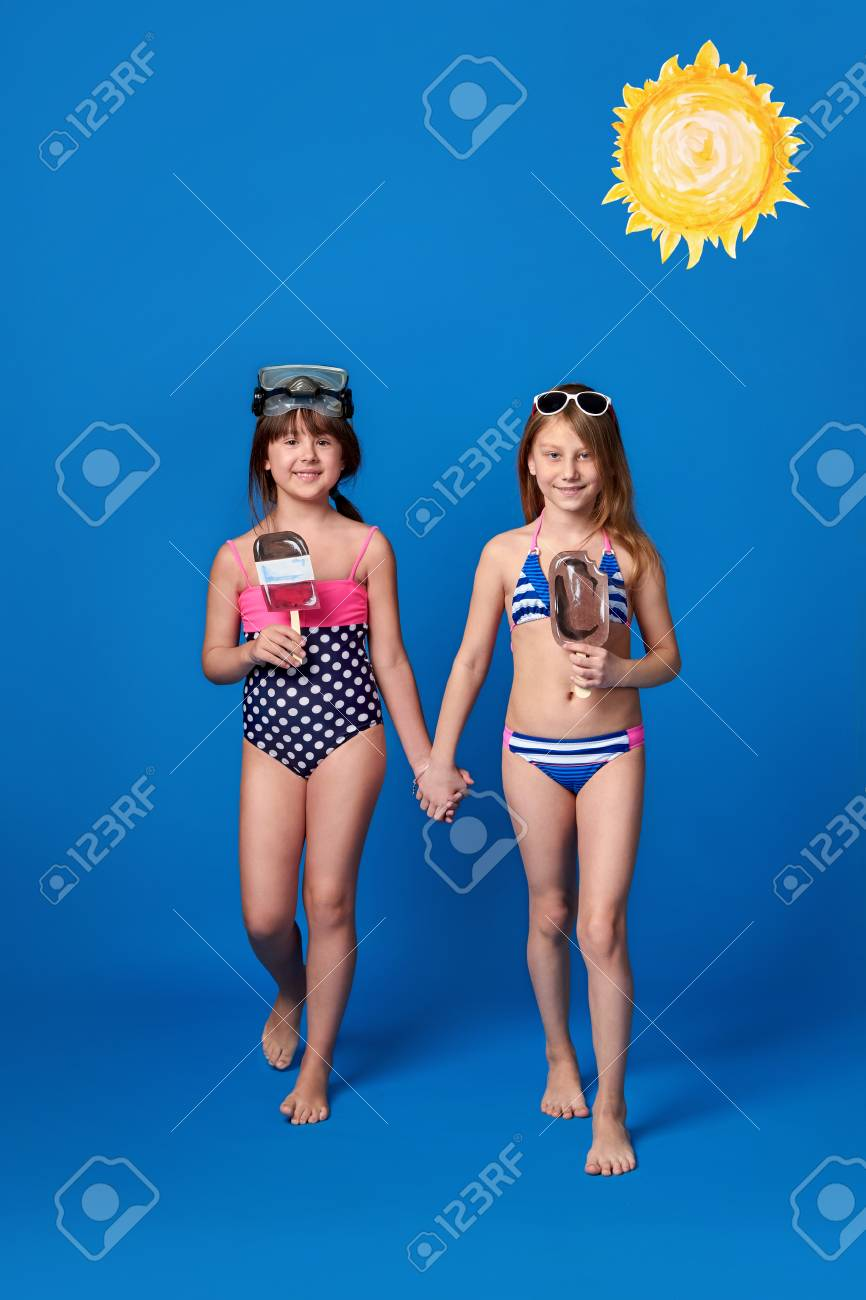 0dcc55ef8b Stock Photo - Studio summer portrait young 2 girls looking at camera. Beach  vacation concept. Girlfriends wear swimsuits,sunbathing,swimming in water,  ...
