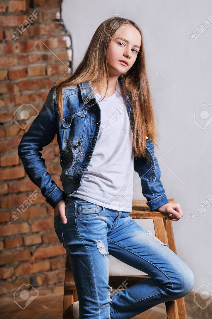 c59821ae80 Fashion portrait beautiful young woman, girl wearing blank white cotton T- shirt, denim