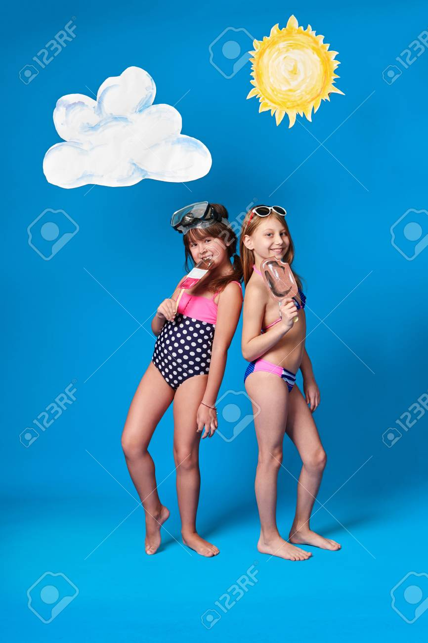 Concept Summer Beach Children Girls Model Colorful Swimsuit Posing Holding Stock Photo Picture And Royalty Free Image Image 104517623