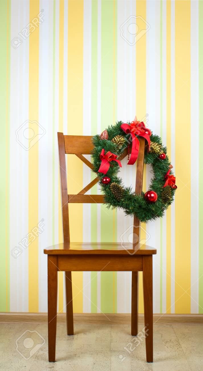Wooden Chair With Christmas Decoration On Wall Background Stock ...