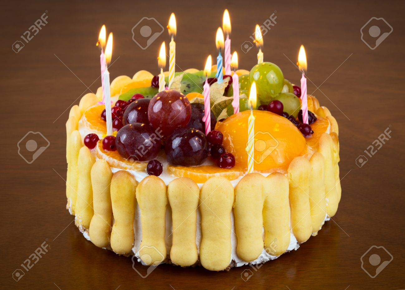 Happy Birthday Fruit Cake With Candles On Wooden Table Background