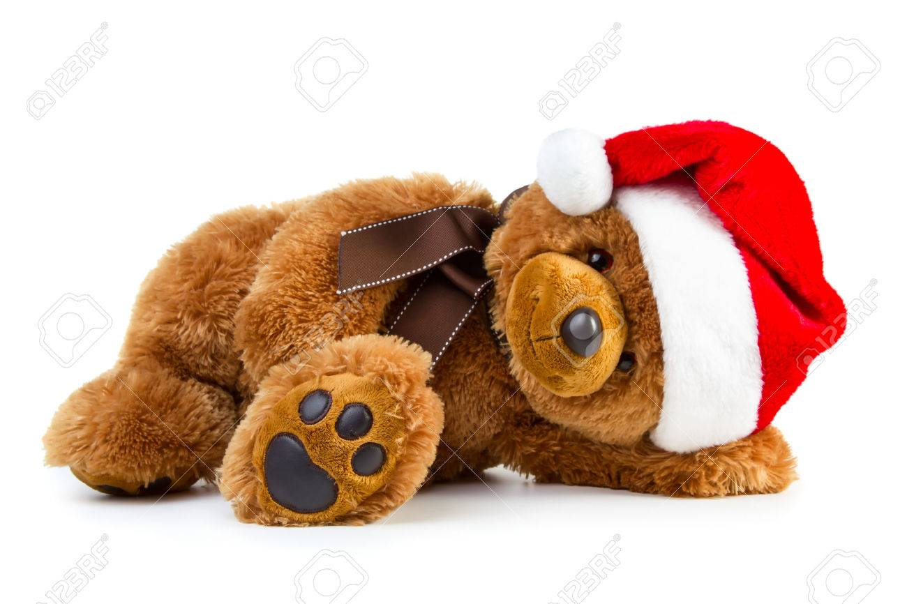 a7dbda6cde5bb Stock Photo - Toy teddy bear wearing a santa hat isolated on white  background