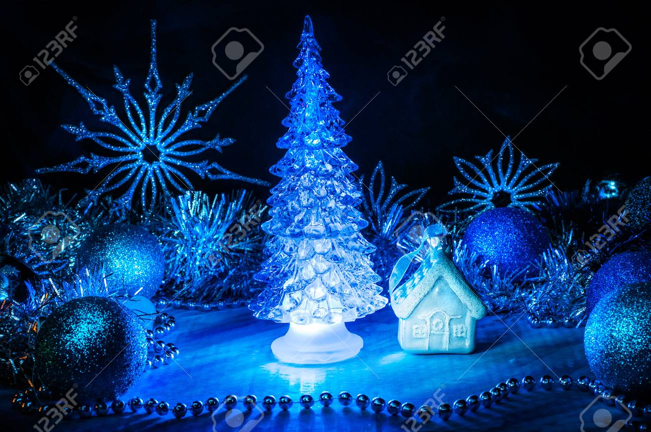 Icy Christmas Tree Glowing With Blue Light On A Blue Background Stock Photo Picture And Royalty Free Image Image 90932848
