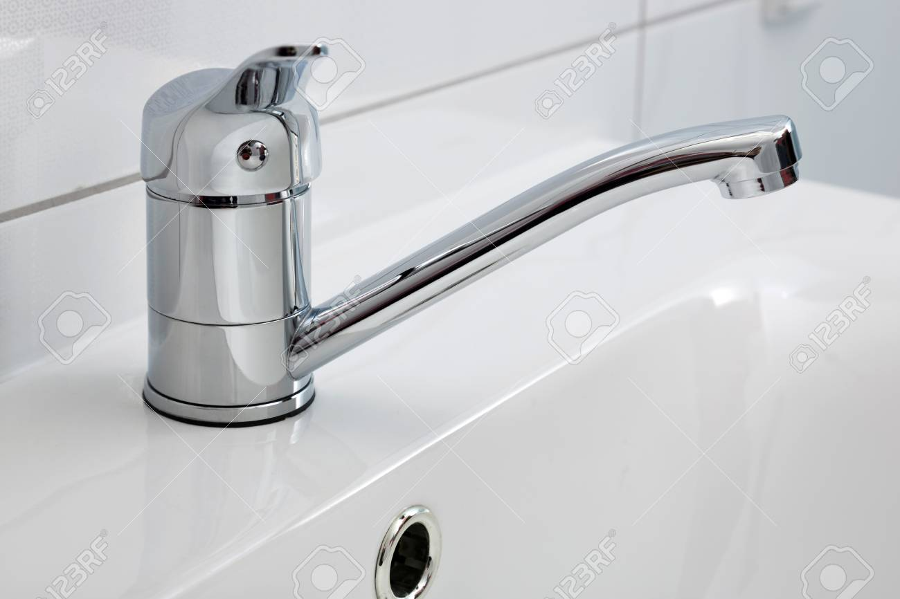 a modern bathroom faucet close up installed on the sink stock photo 90153070 - Modern Bathroom Faucets