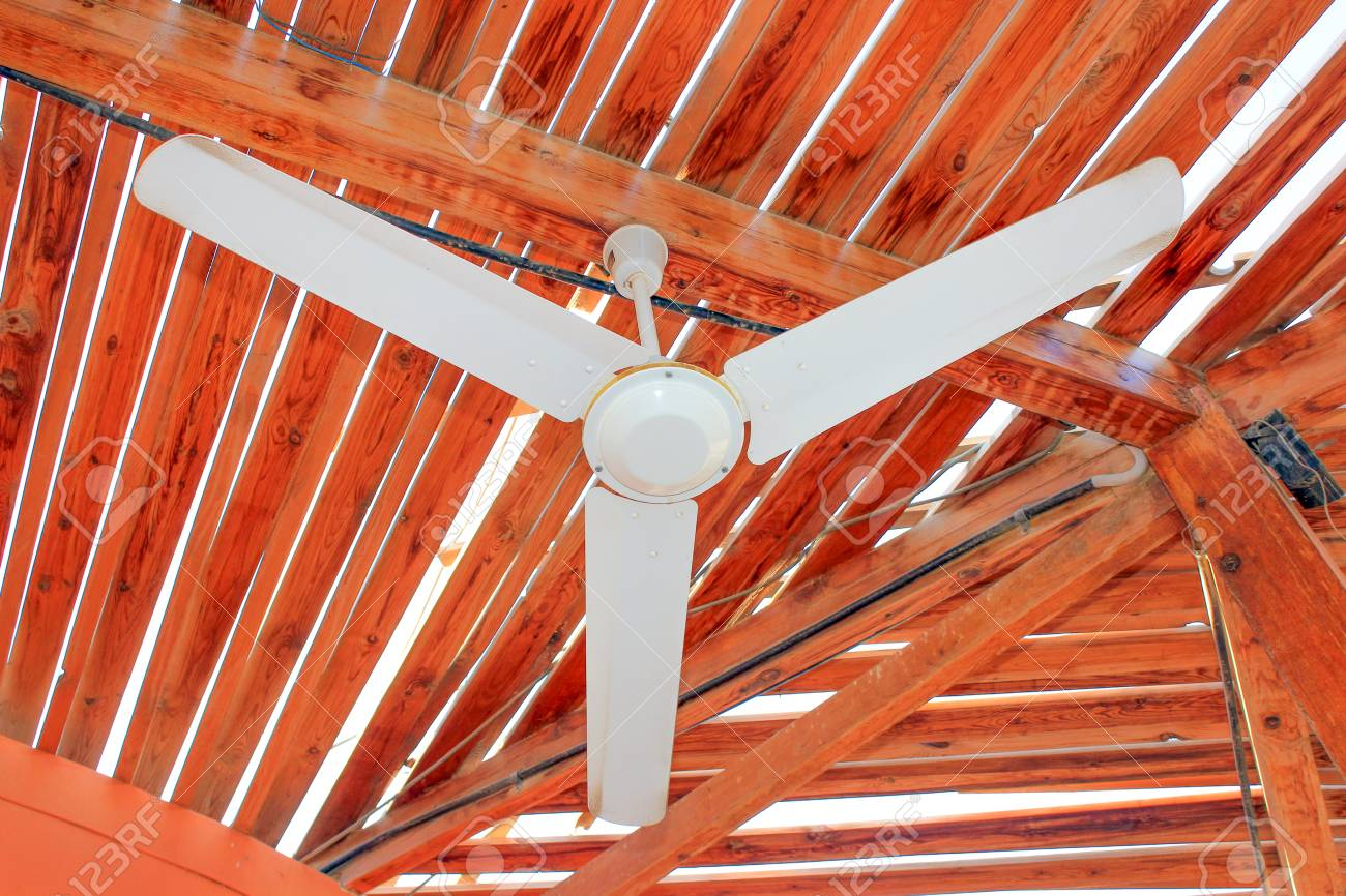 Old Vintage White Ceiling Fan Attached On Wooden Roof Planks Stock Photo Picture And Royalty Free Image Image 89506651