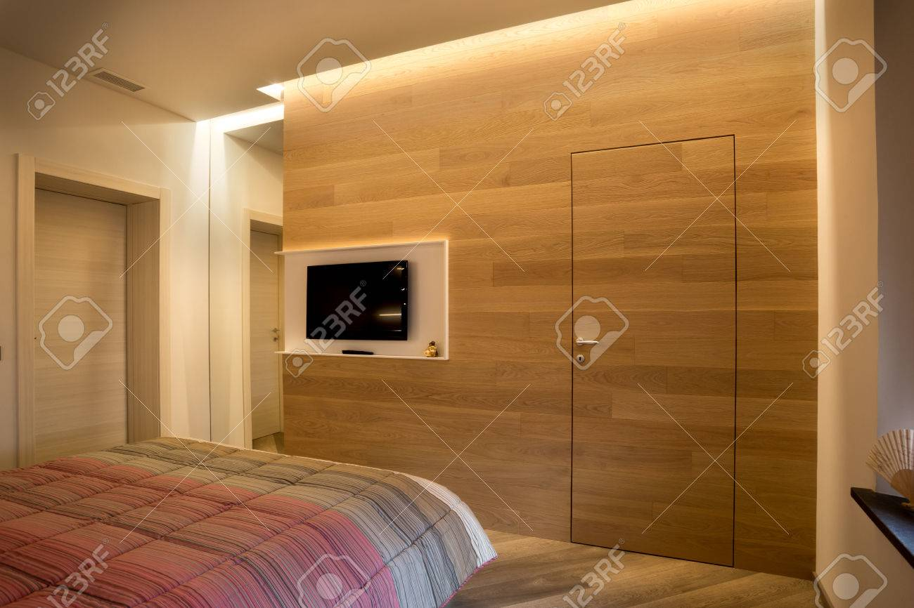 Picture of: Wooden Tv Wall With Mirror And Door Incorporated Stock Photo Picture And Royalty Free Image Image 76260569