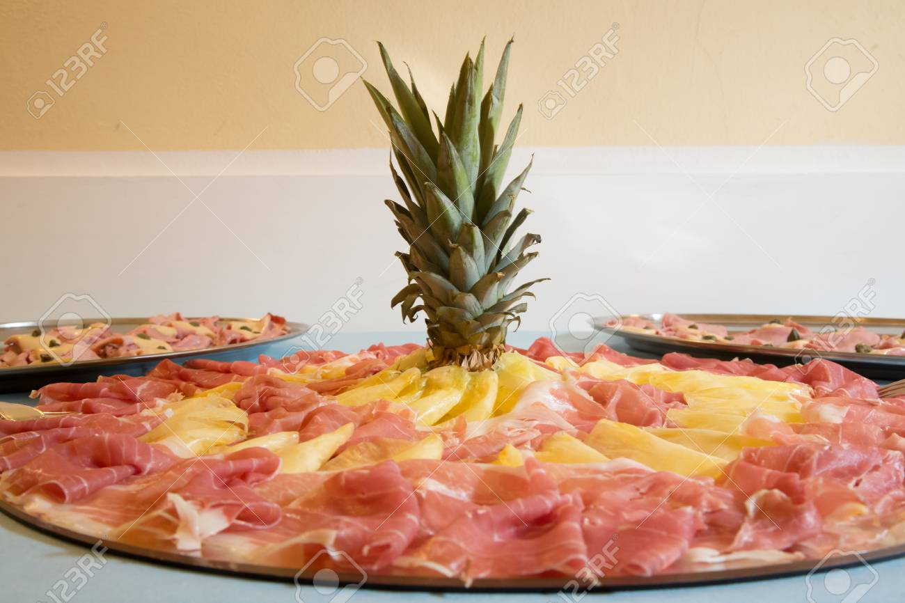 Ananas Buffet trays of cold cuts, parma's ham and ananas, front view stock photo