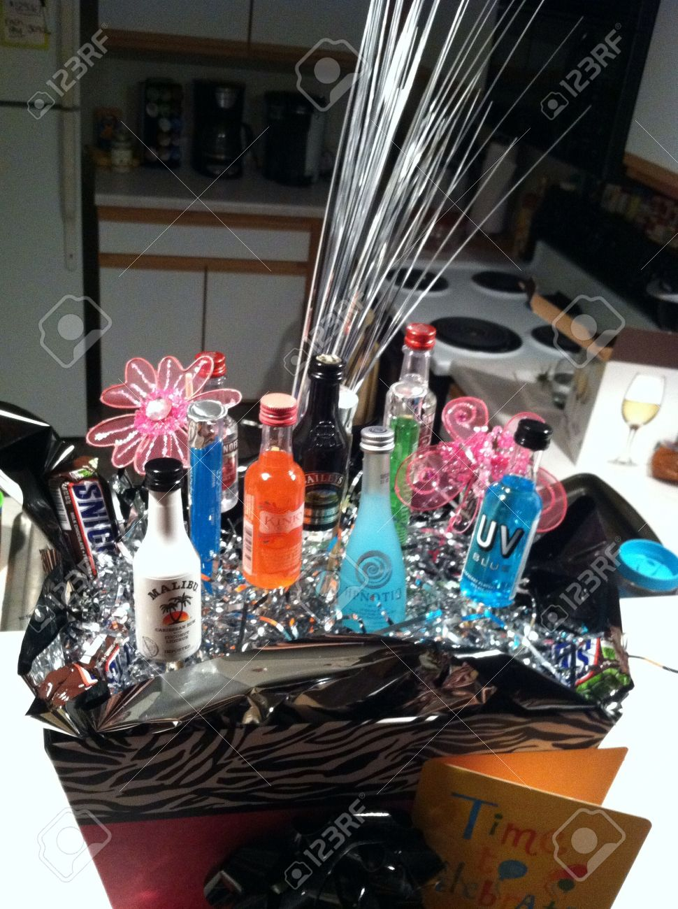 21st Birthday Gift Basket With Alcohol Bottles Stock Photo