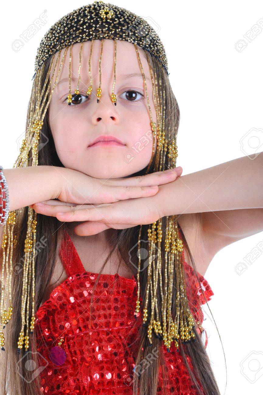 Little girl in a beaded hat clasped her hands under her chin. Isolated on white background Stock Photo - 6820543