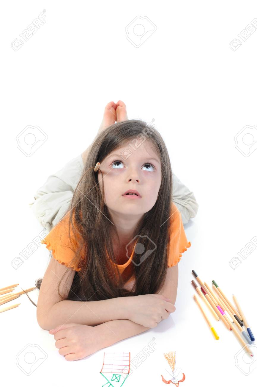 Little beautiful girl draws pencil lying on the floor. Isolated on white background Stock Photo - 6883152
