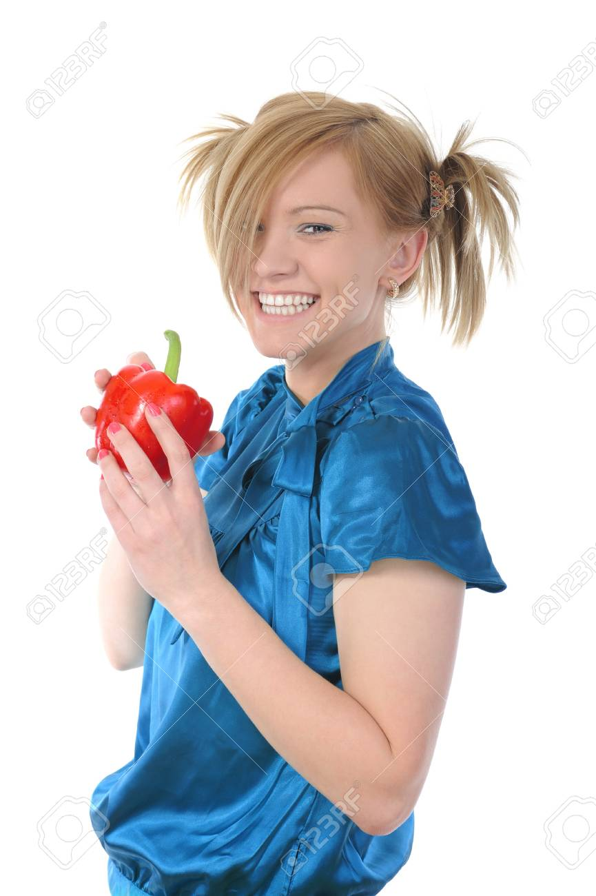 Beautiful smiling girl holding a red pepper. Isolated on white background Stock Photo - 6970500