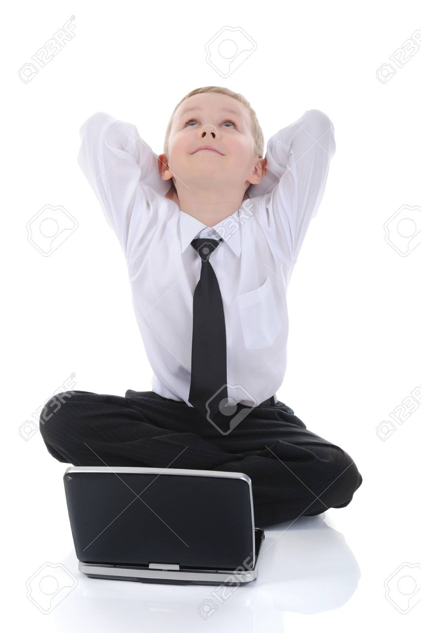 little boy with a laptop sitting on the floor. Isolated on white background Stock Photo - 6970556