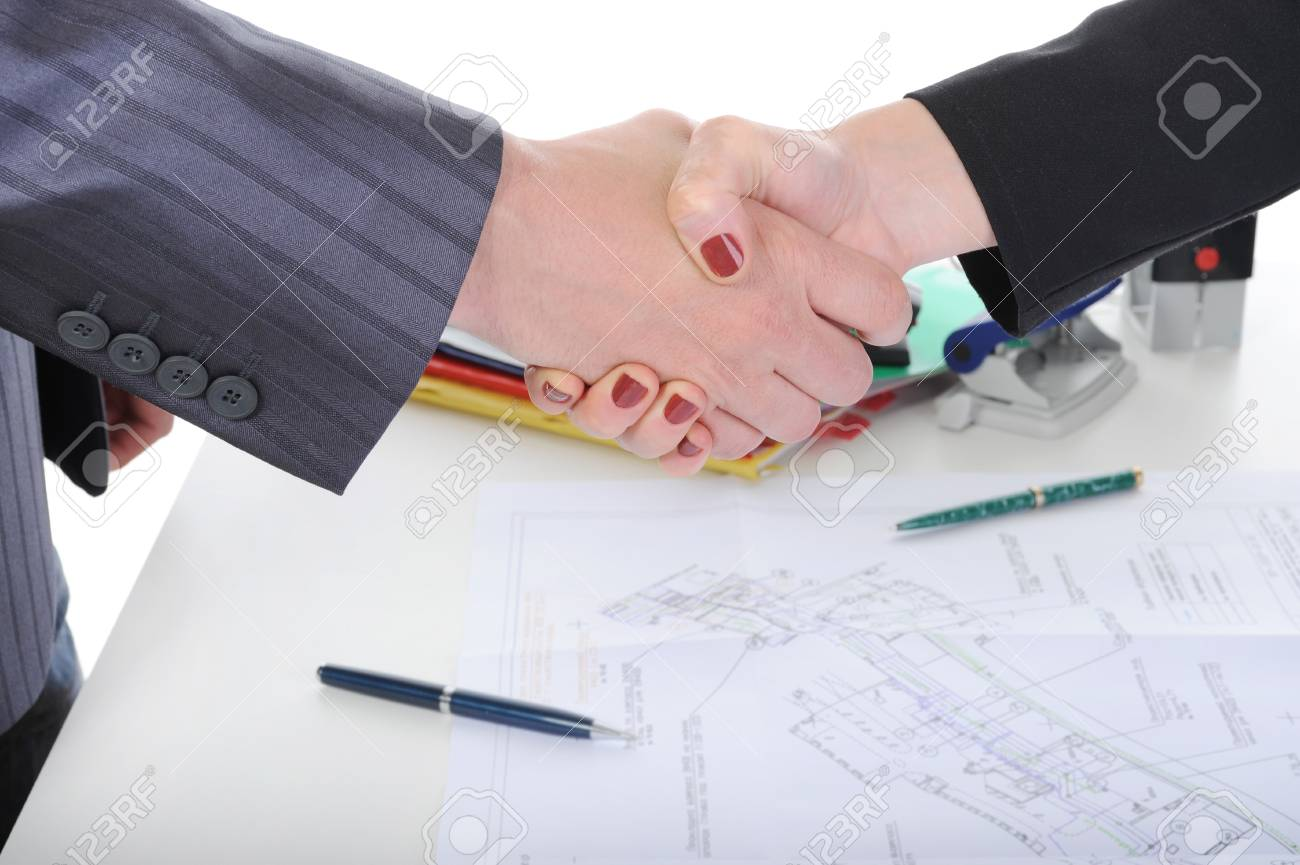 Handshake of business partners, when signing documents. Stock Photo - 6970575