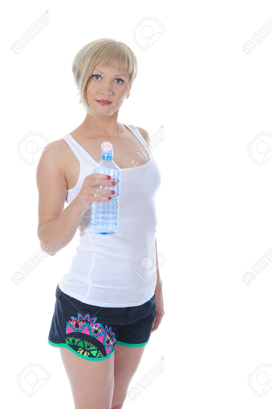 Beautiful girl with a bottle of water. Isolated on white background Stock Photo - 7013875
