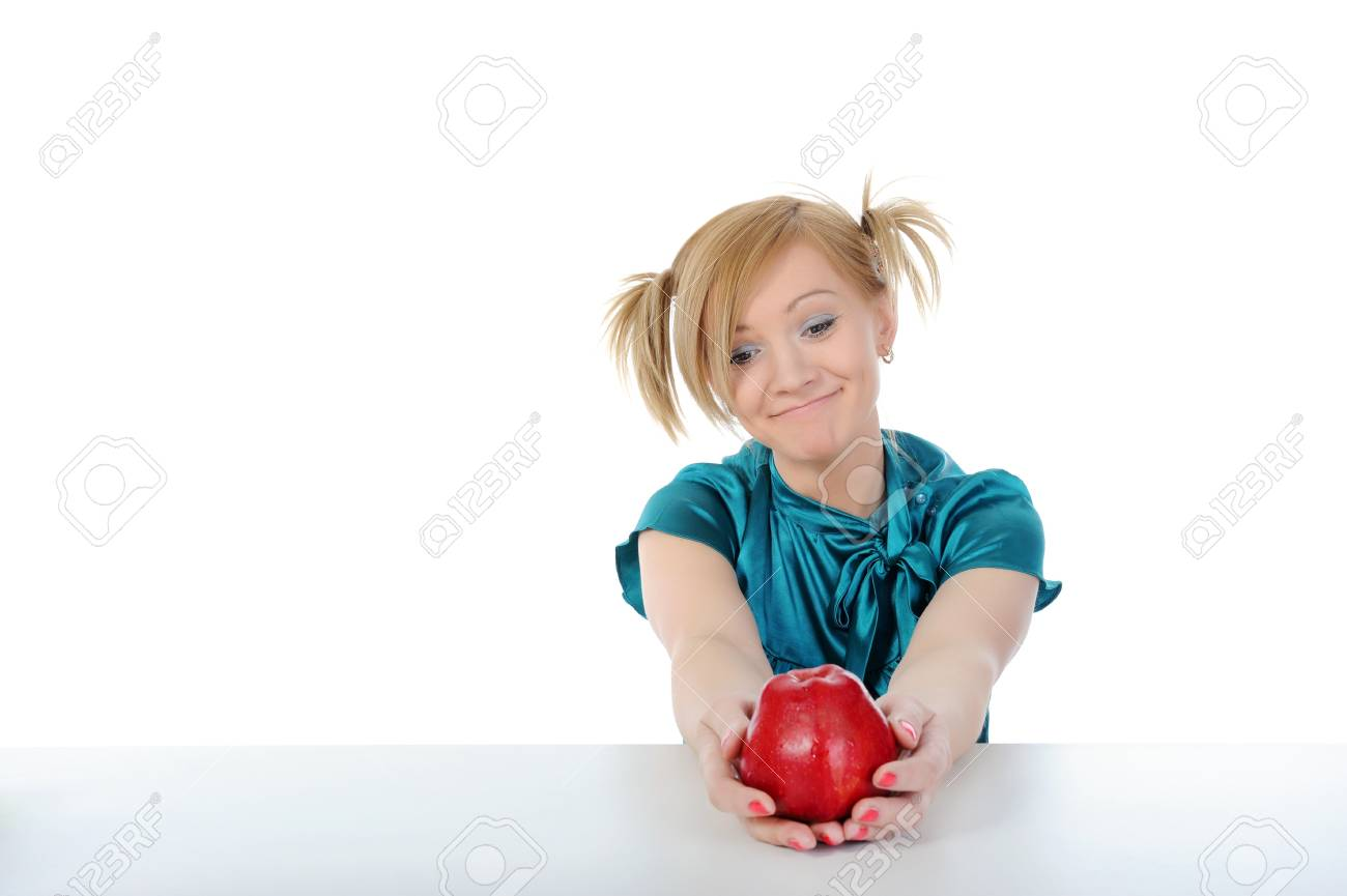 Beautiful smiling girl with an apple. Isolated on white background Stock Photo - 7044753