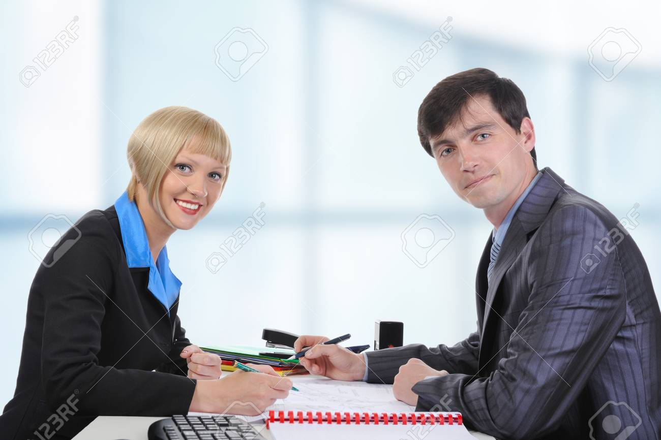 Business man and woman when signing documents. Stock Photo - 7227763