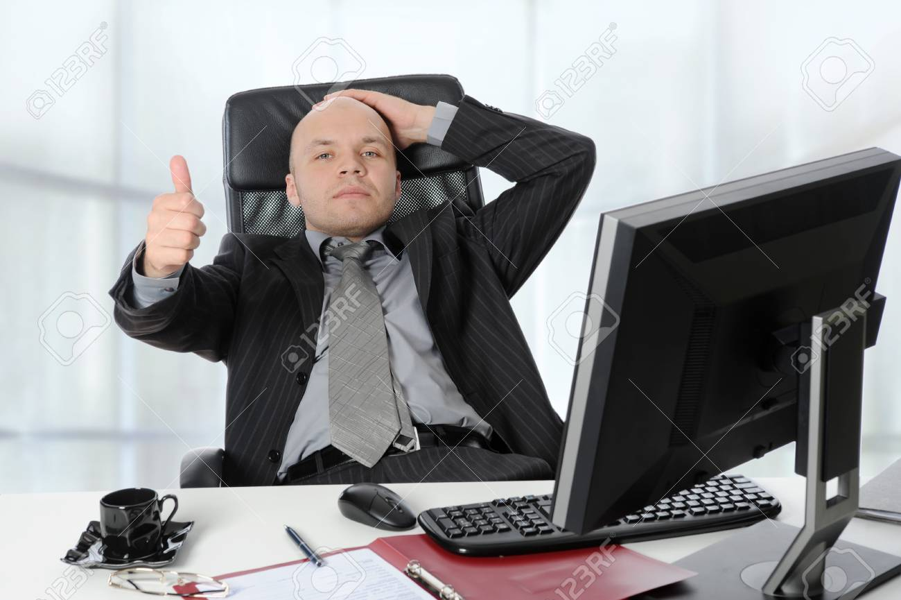 young businessman in the office shows the thumb. Stock Photo - 7281191