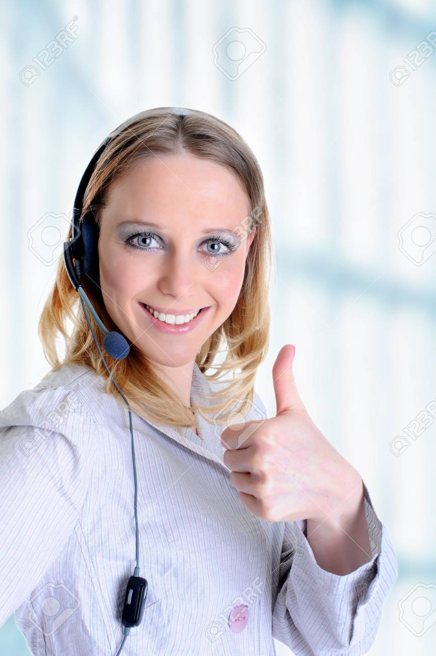 Portrait of a beautiful girl with a headset in the office Stock Photo - 7275532