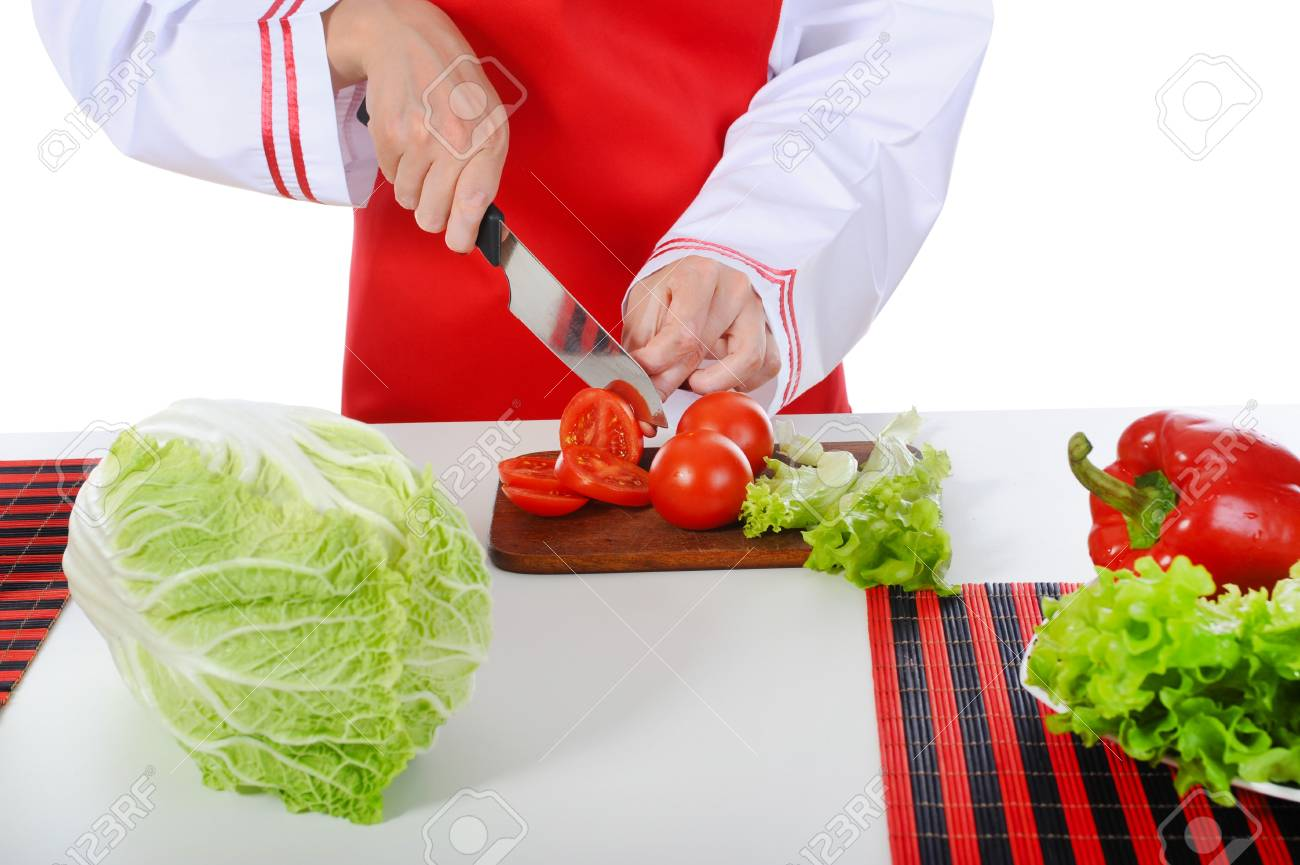 chef cut tomatoes in the kitchen. Isolated on white background Stock Photo - 7364942
