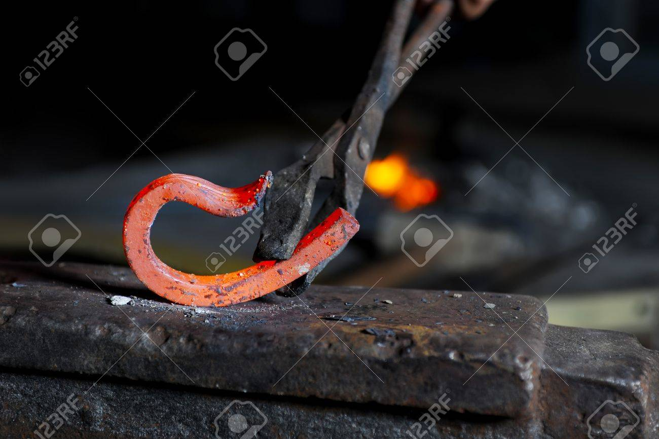 Incandescent element in the smithy on the anvil Stock Photo - 7545743