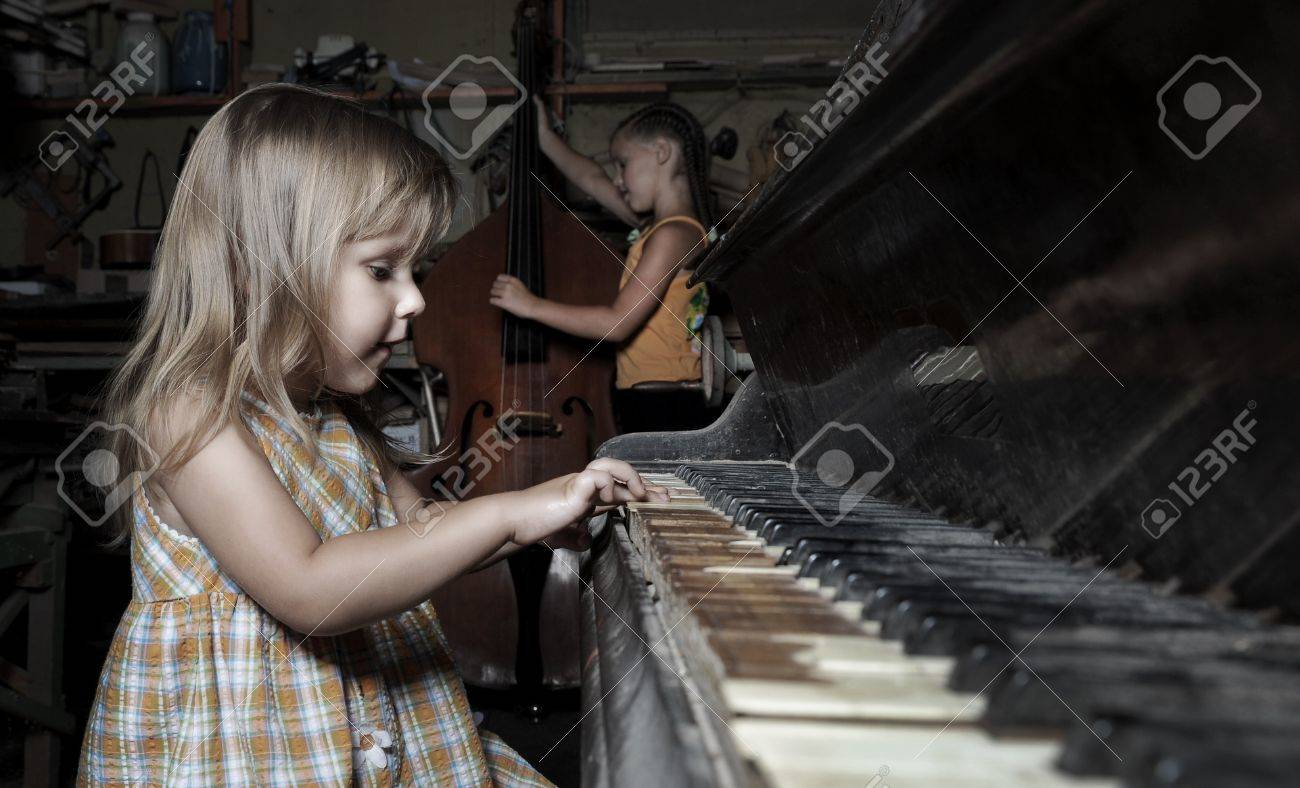 girl playing on an old piano in an abandoned building Stock Photo - 7563984