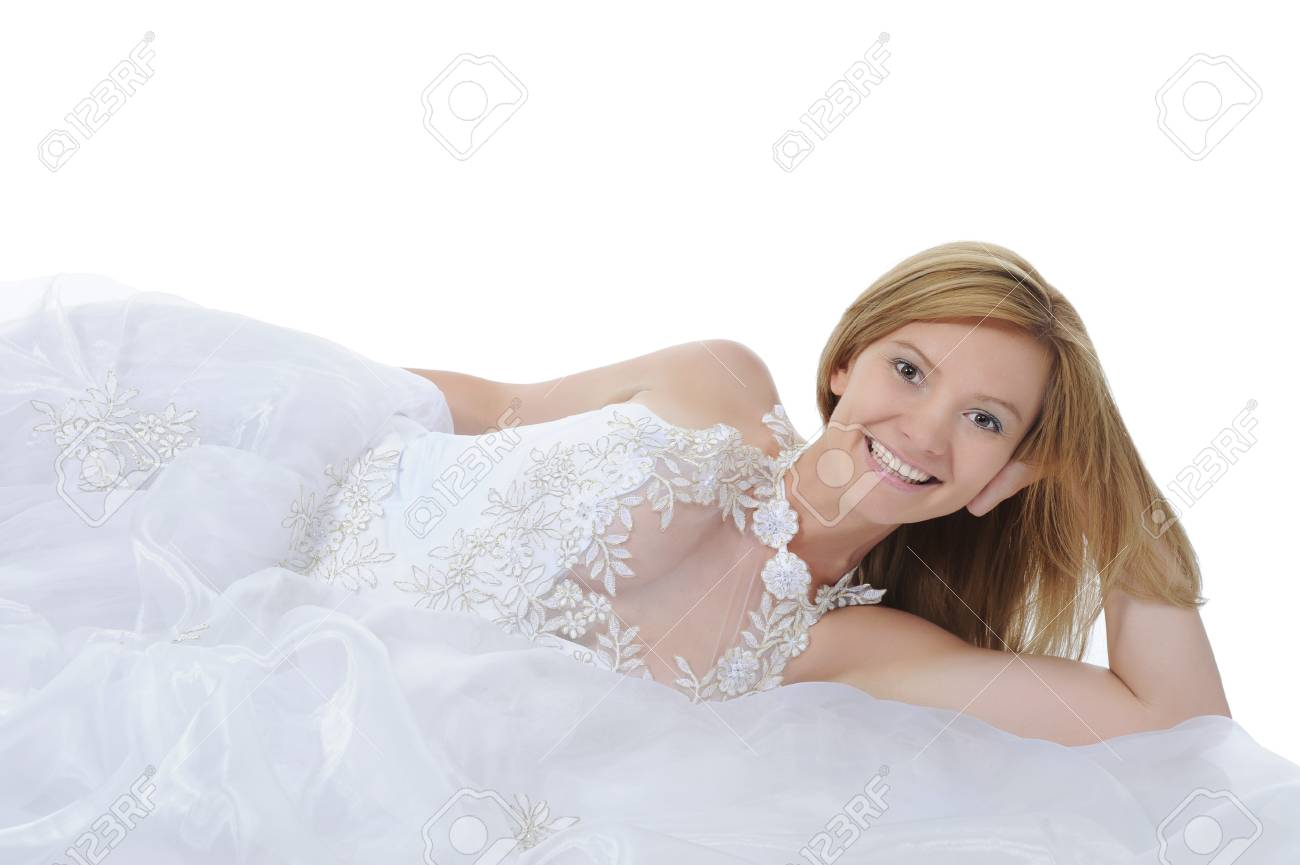 Happy bride lying on the floor. Isolated on white background Stock Photo - 7603929