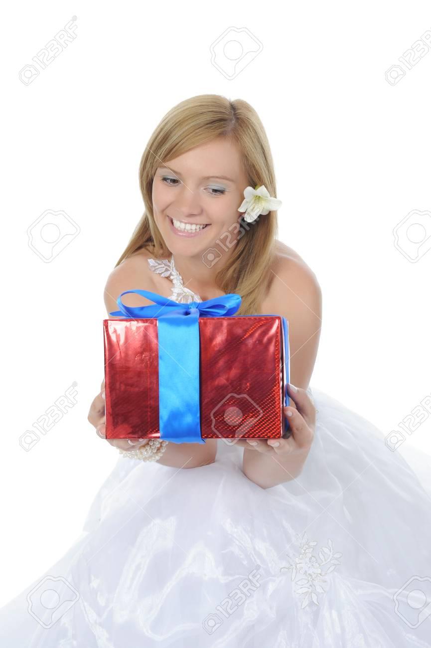Bride hugging gift box. Isolated on white background Stock Photo - 7634323