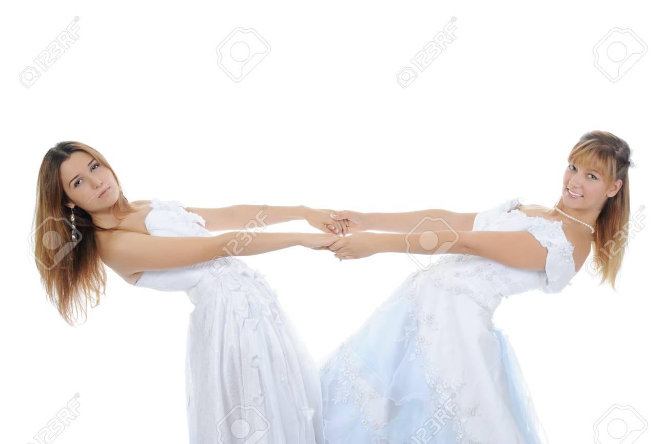 Two beauti bride. Isolated on white background Stock Photo - 7634422