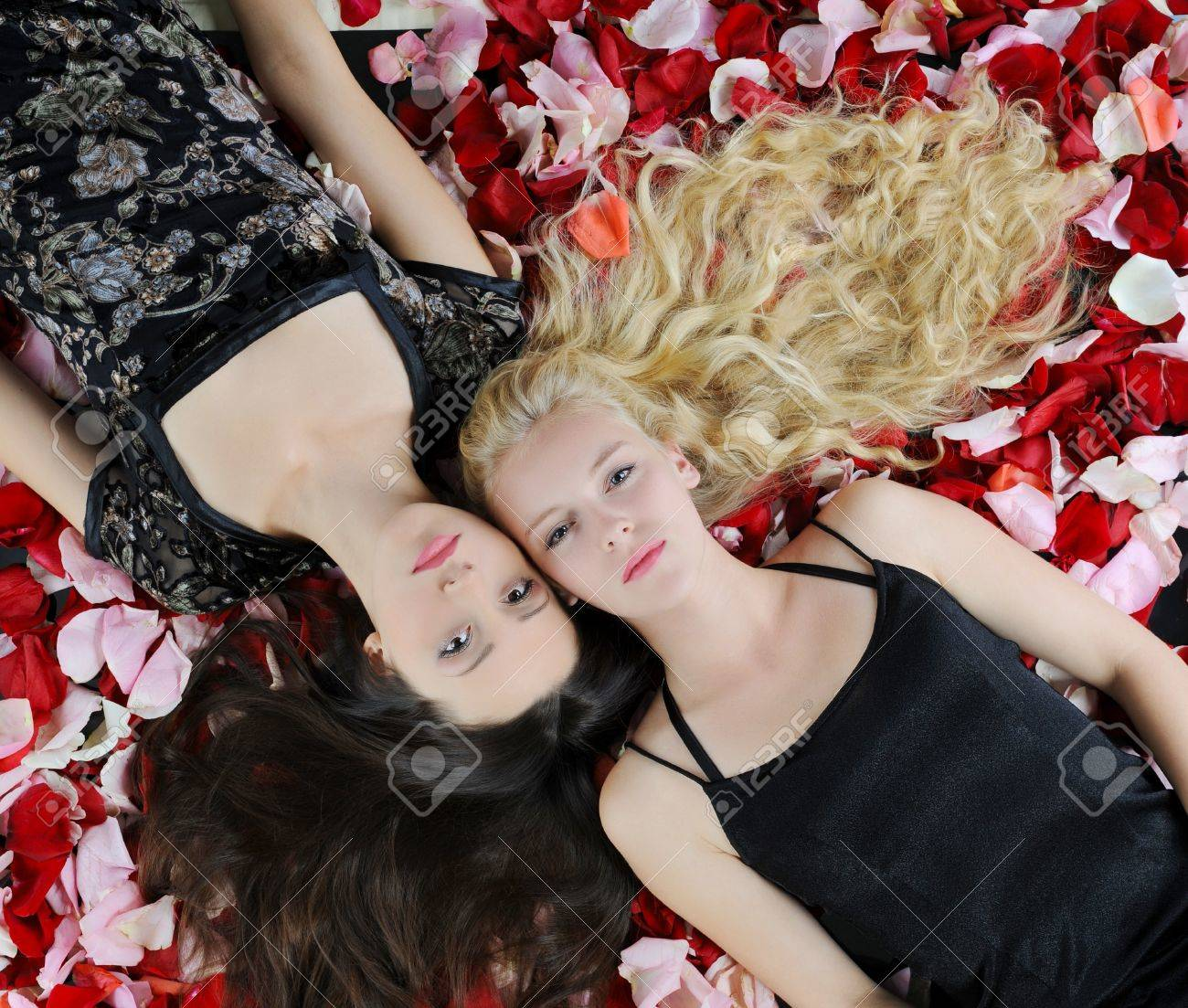 Two beautiful women in rose petals Stock Photo - 7799328