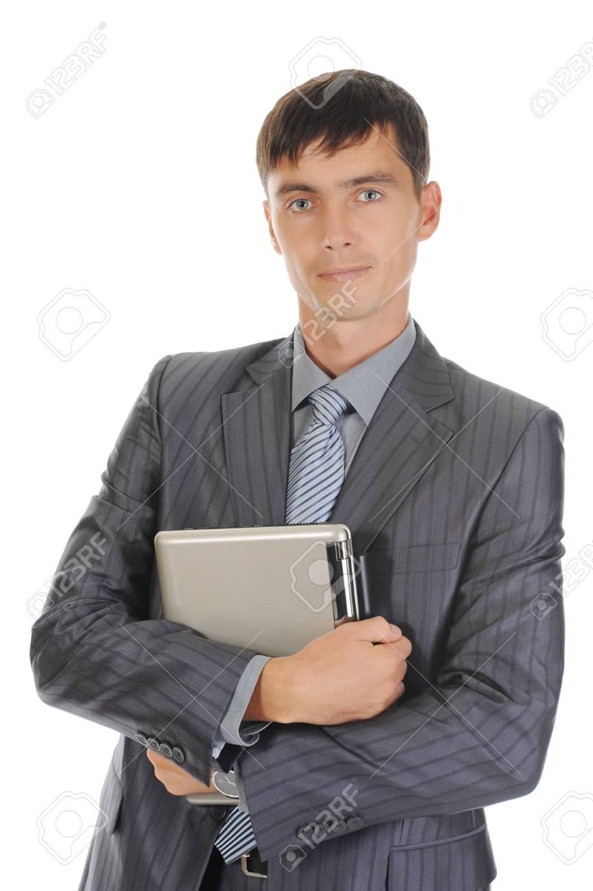 Businessman holding laptop. Isolated on white background Stock Photo - 7799313