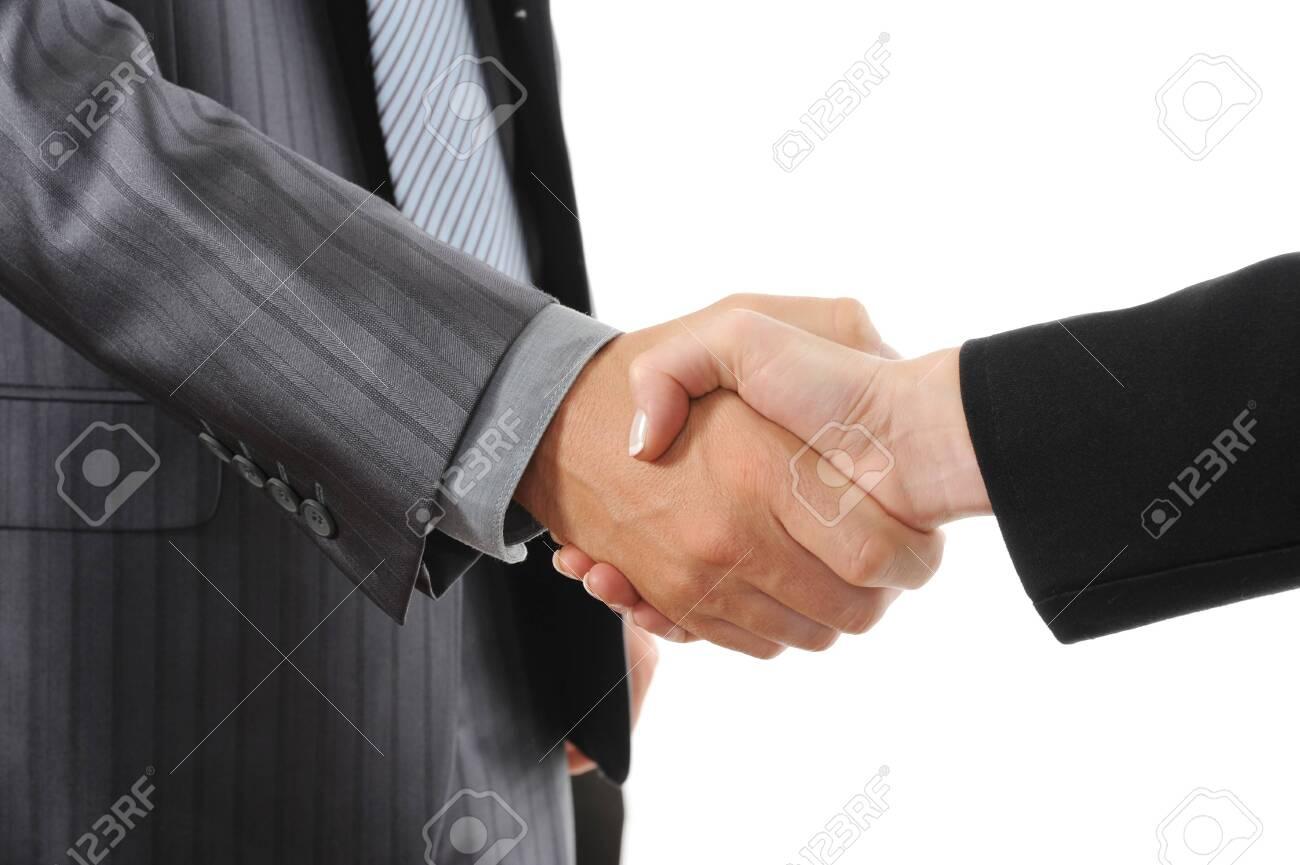 Handshake two business partners. Isolated on white background Stock Photo - 7799306