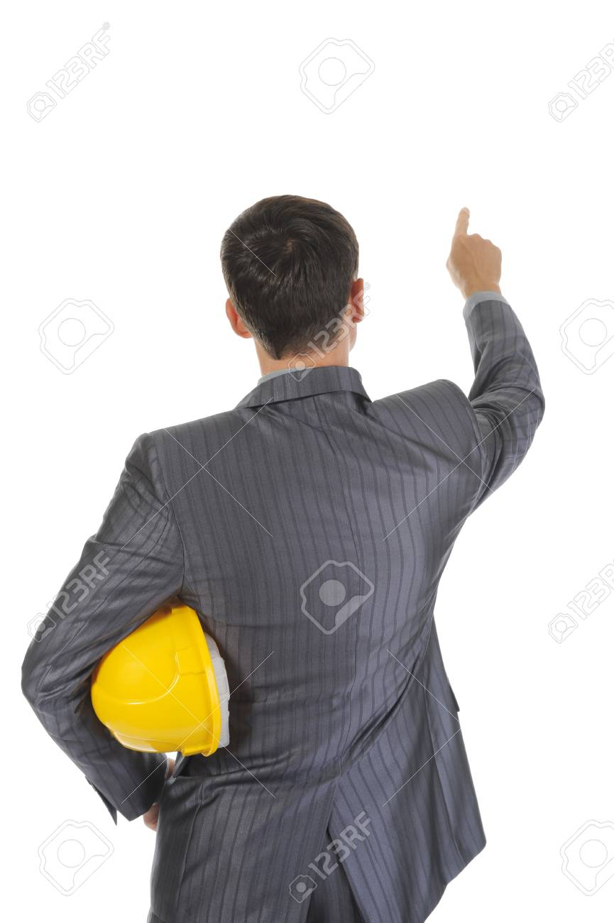 Businessman with helmet points finger up. Isolated on white background Stock Photo - 7799347