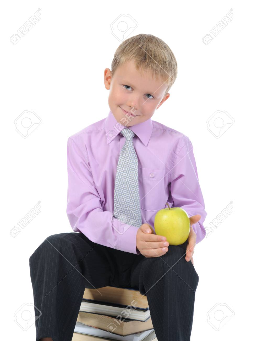 little boy with apple. Isolated on white background Stock Photo - 7799398