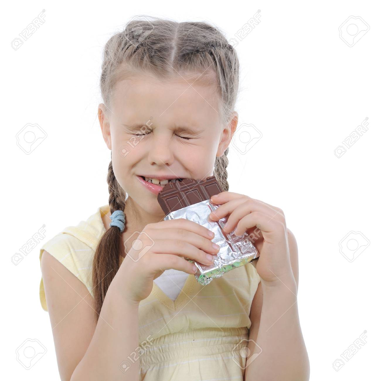 Little girl eating chocolate. Isolated on white background Stock Photo - 7799676