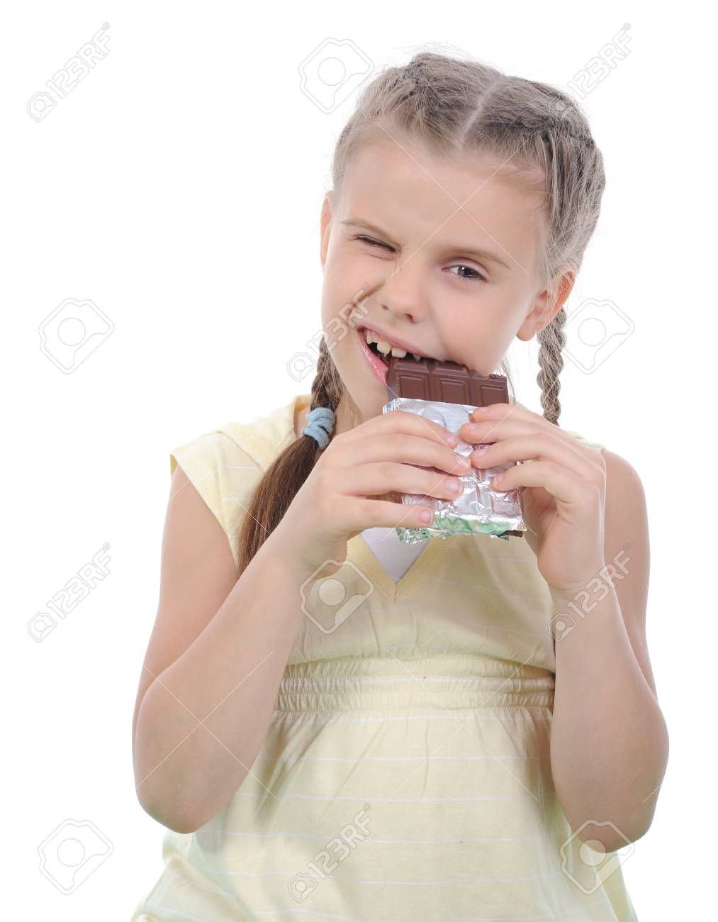 Little girl eating chocolate. Isolated on white background Stock Photo - 7890908