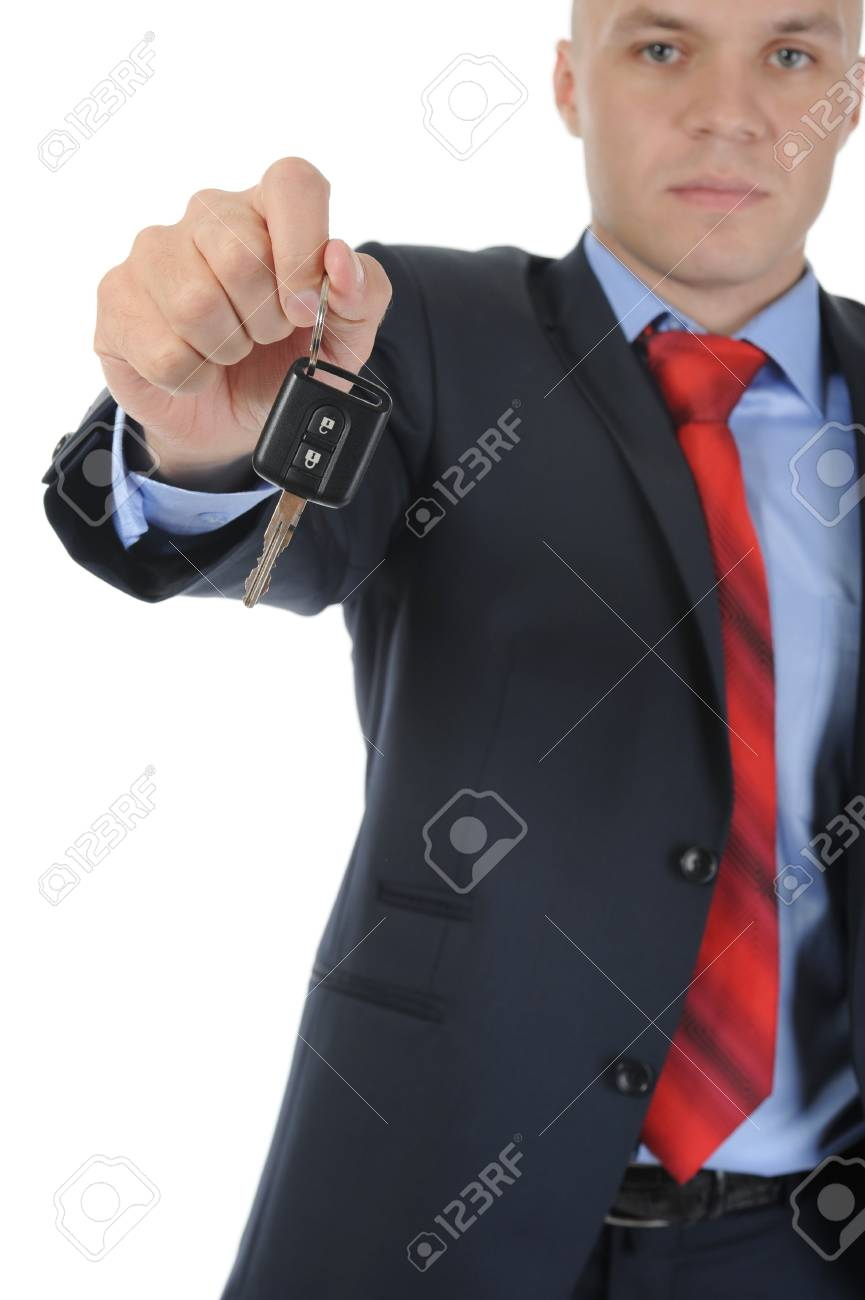 Image of a businessman gives the keys to the car. Isolated on white Stock Photo - 7890968