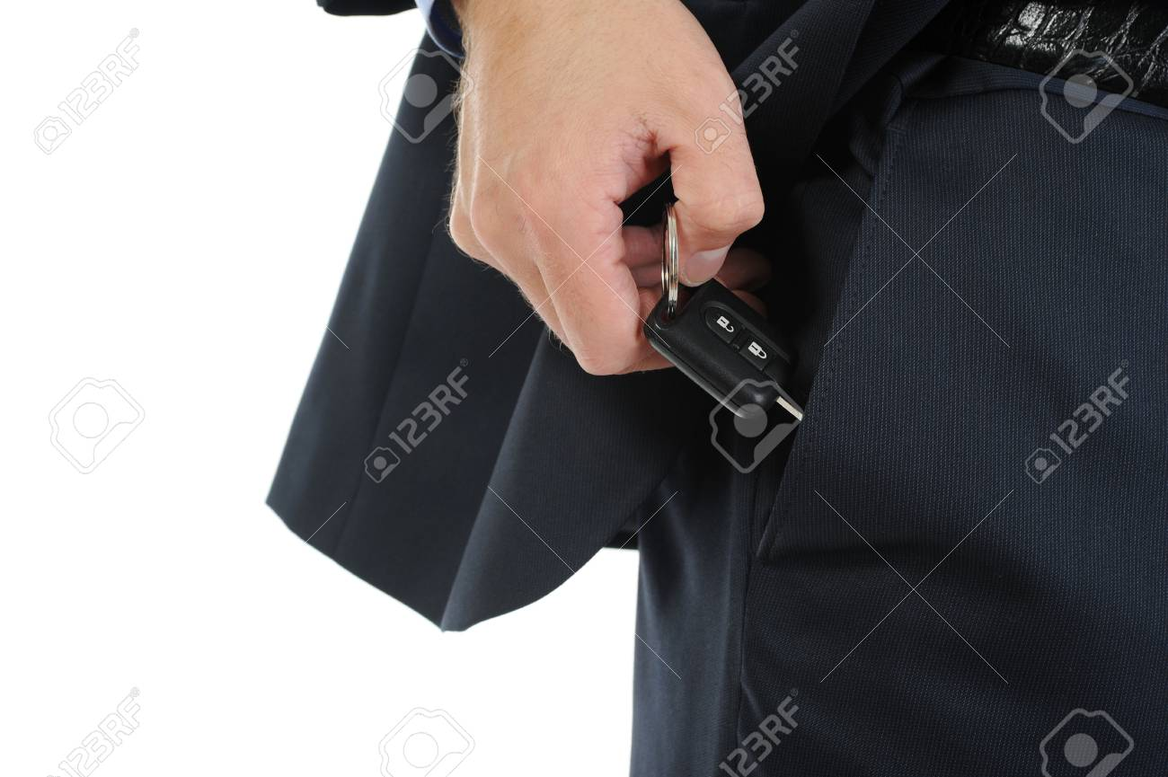 Image of a businessman gets the keys to the car out of pocket. Isolated on white Stock Photo - 7983444