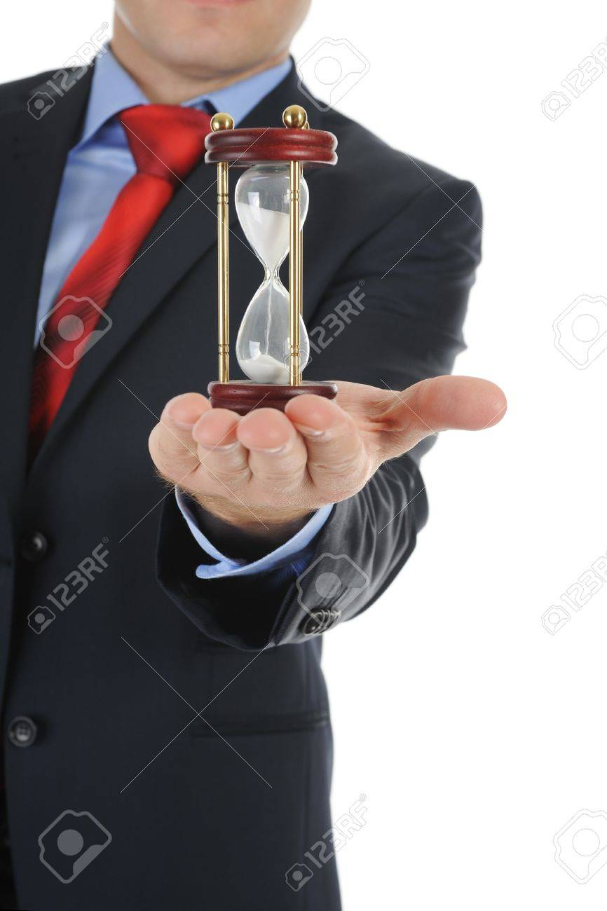 Businessman with hourglass in hand. Isolated on white background Stock Photo - 7983498