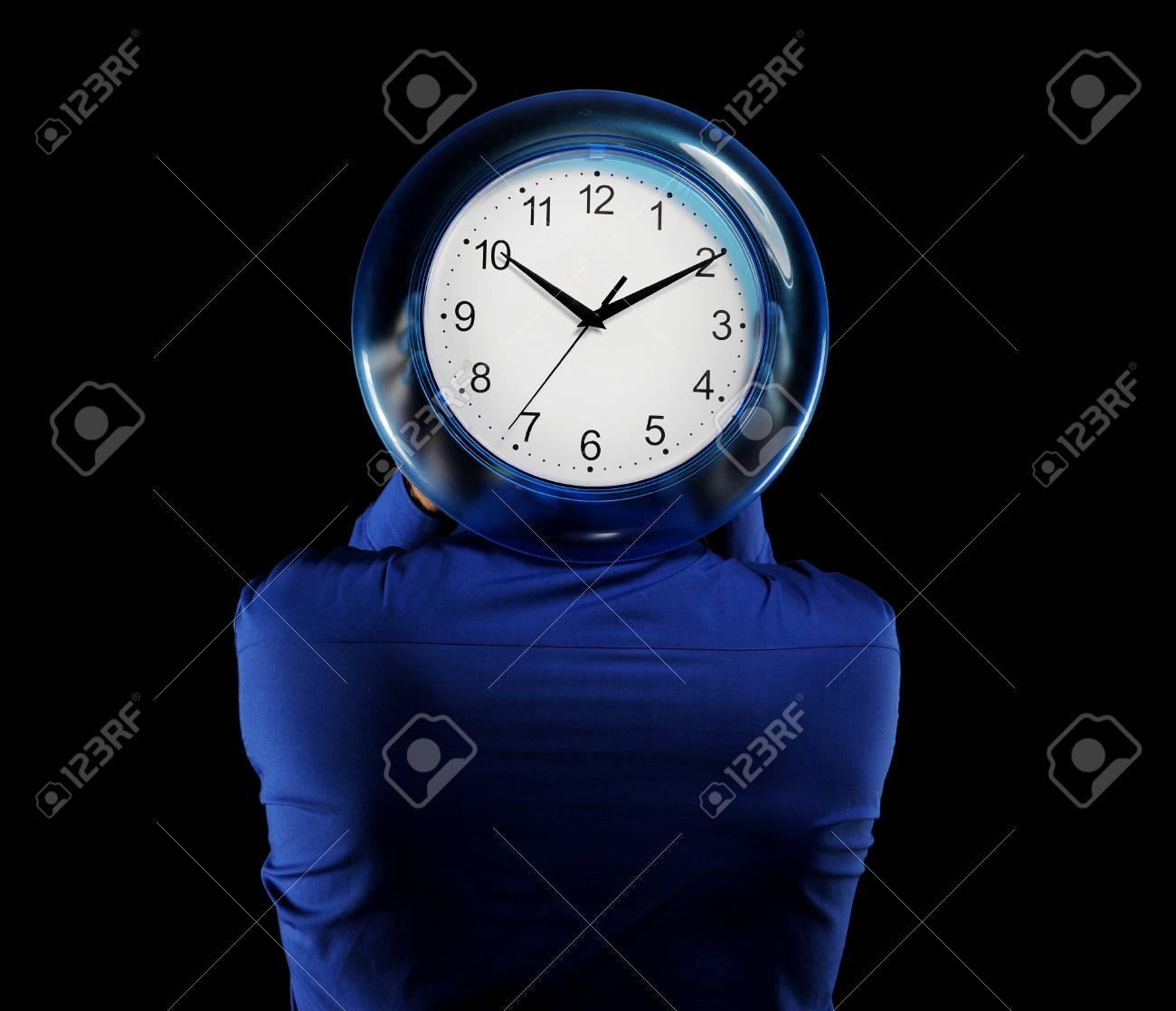 man in a dark blue shirt holds hours in the face of Stock Photo - 7983481
