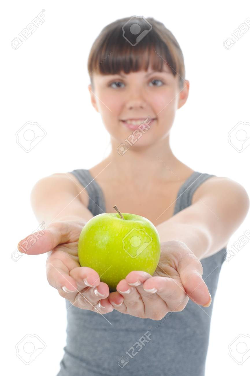 Athletic girl holding a green apple in hand. Isolated on white background Stock Photo - 7983486
