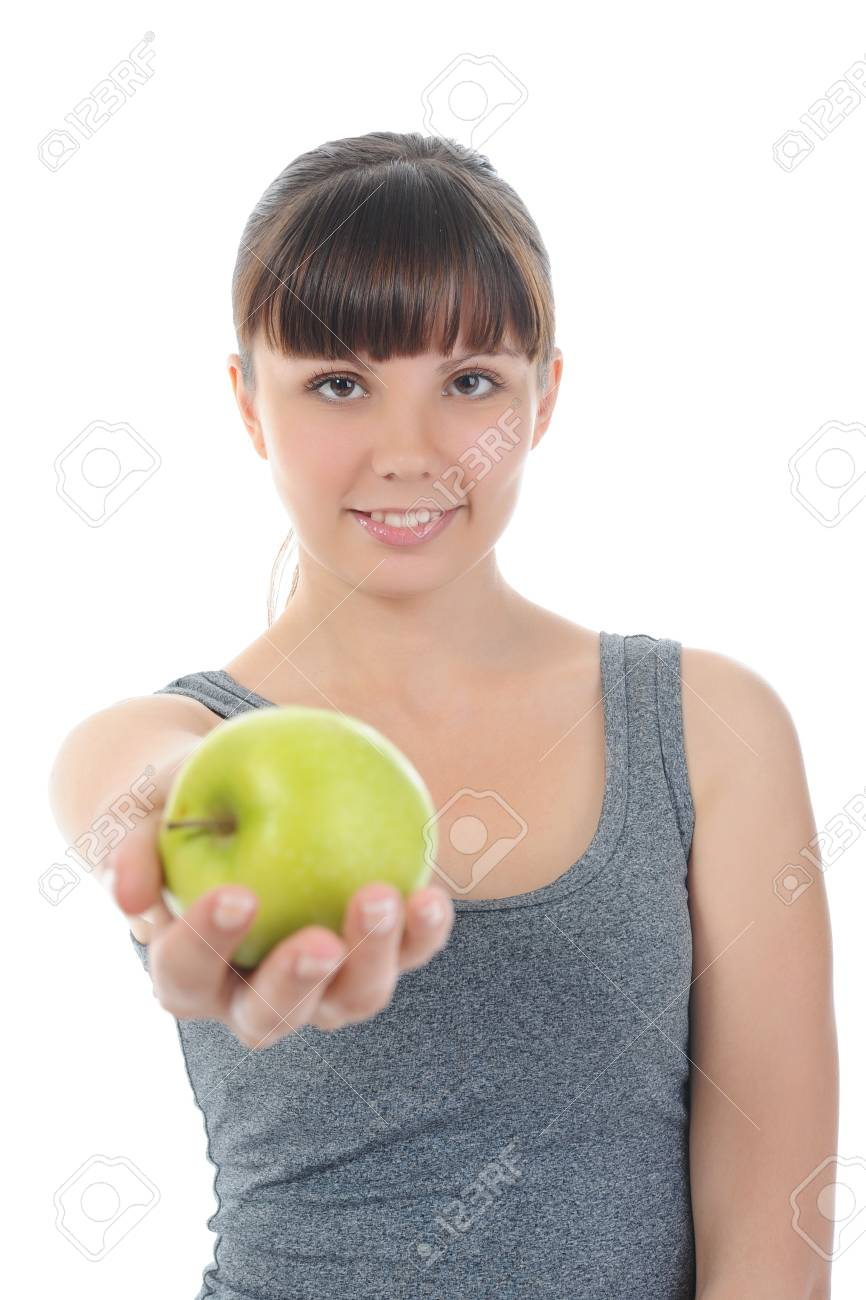 Athletic girl holding a green apple in hand. Isolated on white background Stock Photo - 7983575