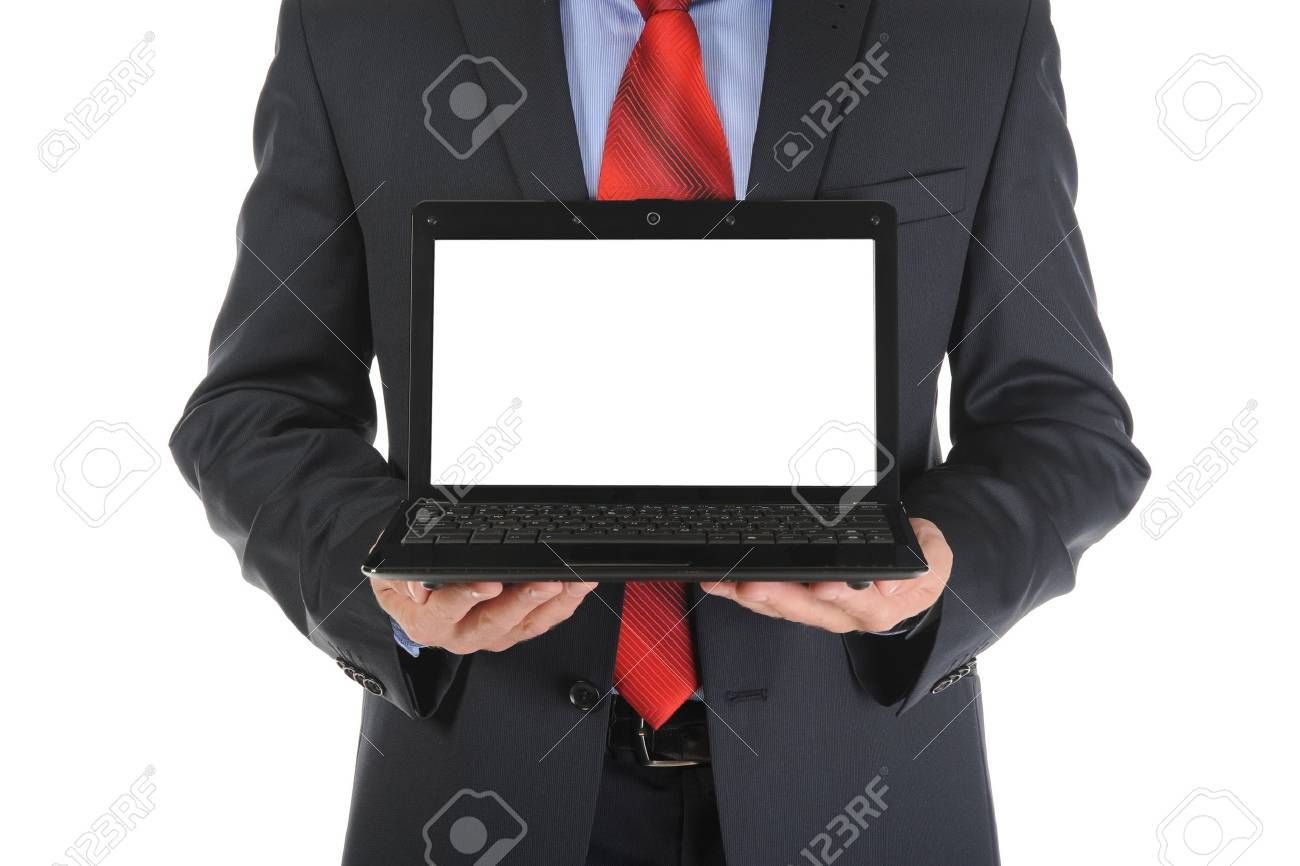 Businessman holding an open laptop. Isolated on white background Stock Photo - 7983622