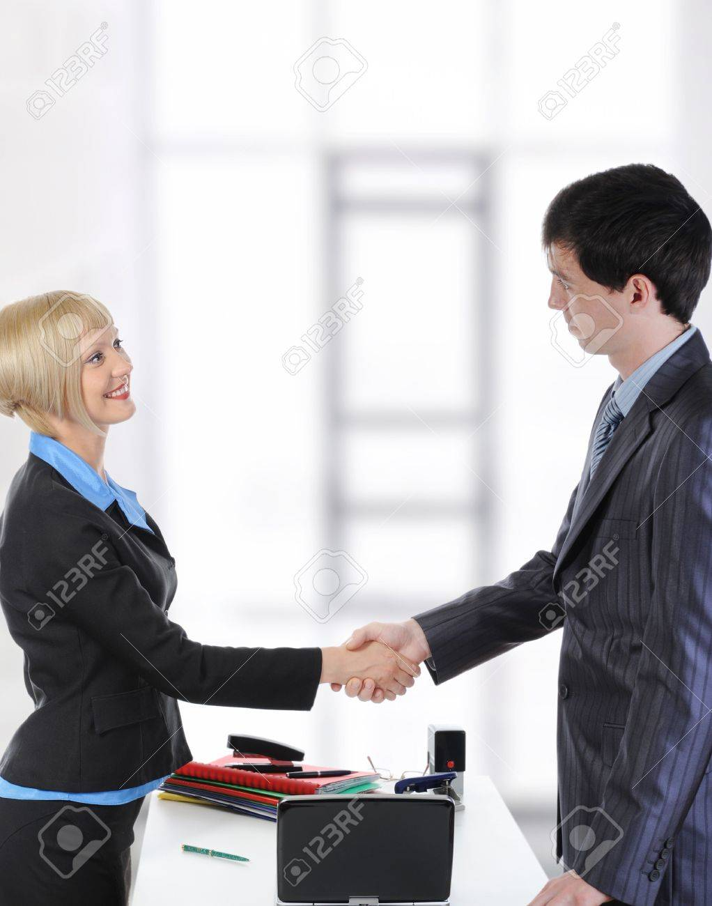 Handshake two business partners in a bright office. Stock Photo - 8061846